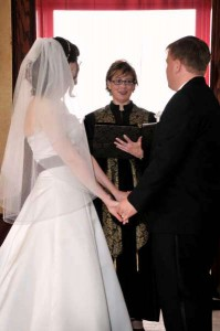 Shelley Dugan officiating at wedding. Beloved Life
